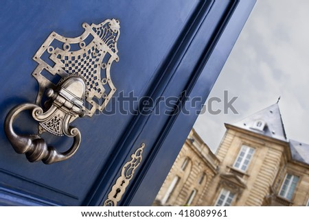 Door and knocker of a French mansion in Bordeaux - stock photo