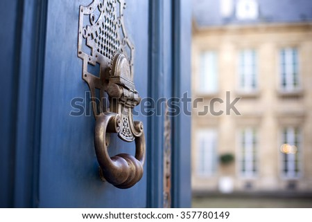 Door and knocker of a stylish French mansion - stock photo