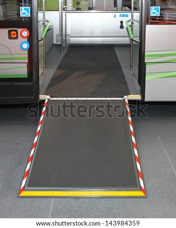 Door and ramp for wheelchair at city bus - stock photo