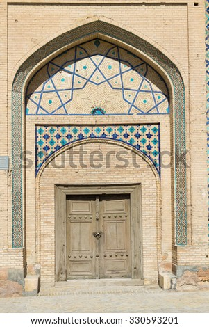 Door and wall with traditional floral decoration in Khiva. Uzbekistan, Central Asia  - stock photo