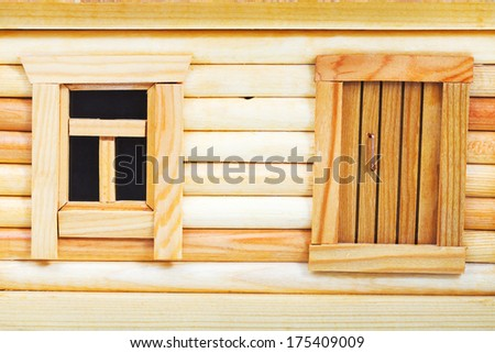 door and window of model of simple village wooden log house isolated on white background