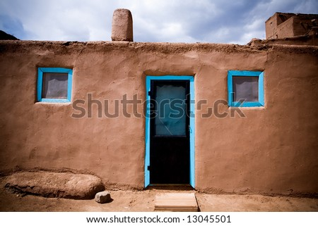 Door and windows in adobe building at Taos Pueblo, New Mexico. - stock photo