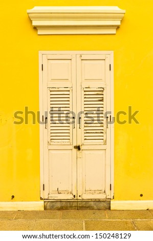 door and yellow color  wall