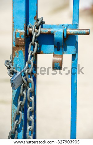 Door closed with a chain and padlock. - stock photo