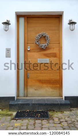 Door decorated for Christmas - stock photo