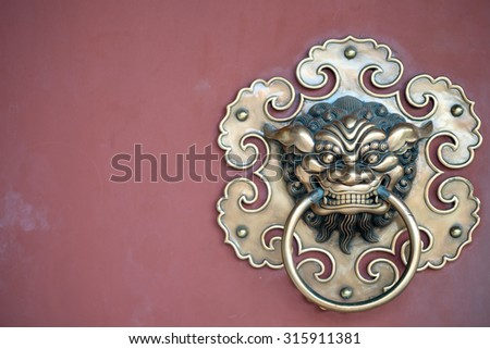 Door Detail of a Buddhist Temple in Singapore. - stock photo