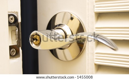 Door Handle Chrome Door Knob Focus on keyhole - stock photo