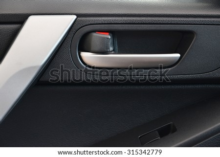 Door handle inside the car. - stock photo
