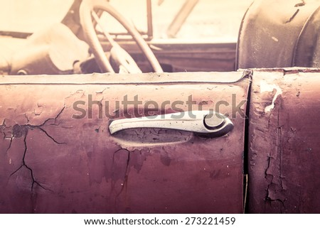 door handle of old dirty vintage car - stock photo