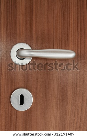 Door handle of plywood