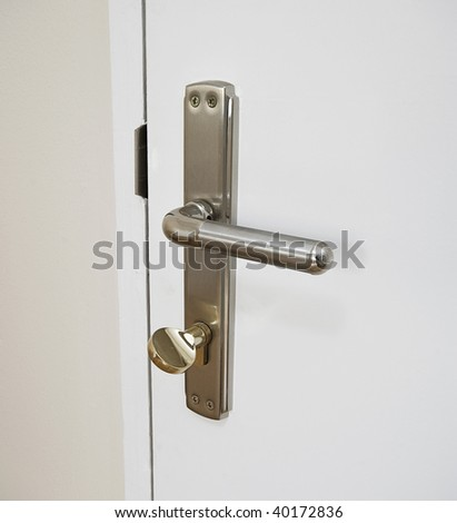 door handle with gold plated lock - stock photo