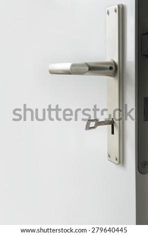 Door handle with key - stock photo