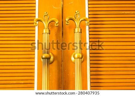Door Handles old antique Made of wood - stock photo