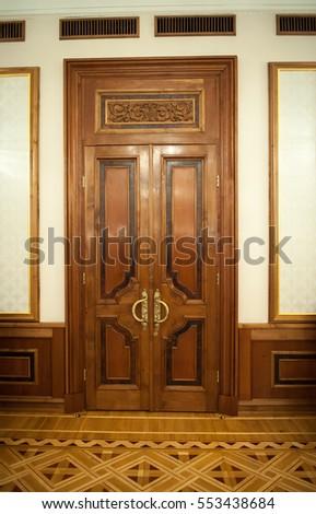 Door Handles With An Old Double Door. Golden Handle Door Entrance. Luxury  Gold Handle