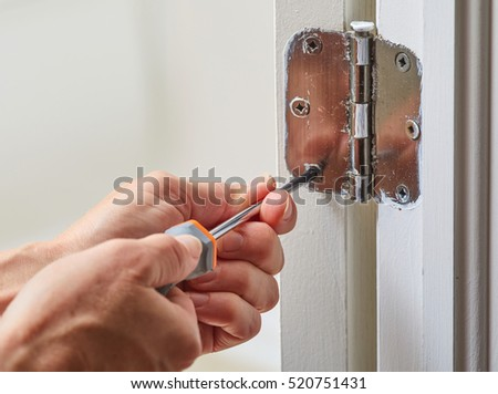 Door hinge installation. & Fixing Door Hinges Stock Images Royalty-Free Images \u0026 Vectors ... Pezcame.Com