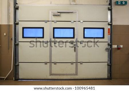 Door in garage - stock photo