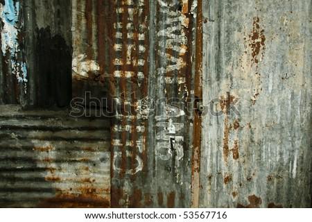 door in rusty metal wall in the philippines - stock photo