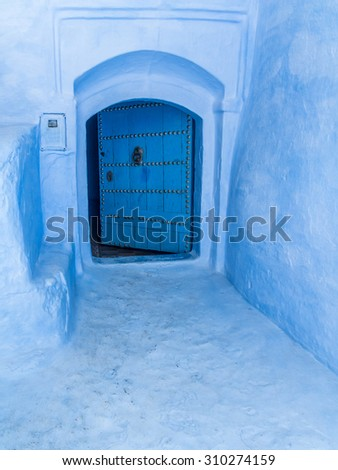 Door in the blue medina of Chefchaouen, Morocco - stock photo