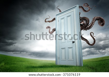 Door in the fields with monster waiting - stock photo