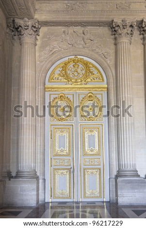 Door in the interior of the Versailles Palace in Paris, France - stock photo