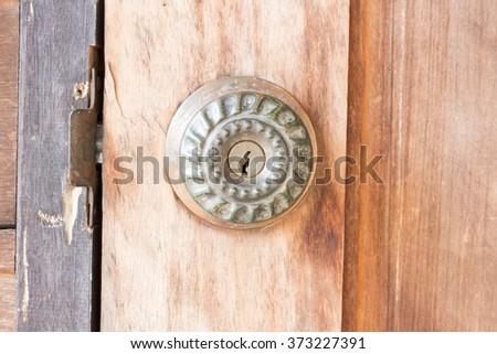 door knob old on the old wooden door - stock photo