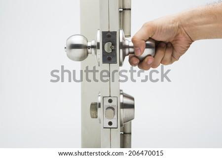 Door knobs, aluminum door white background. - stock photo