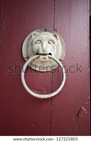 Door Knocker in lion style on Old chinese door - stock photo