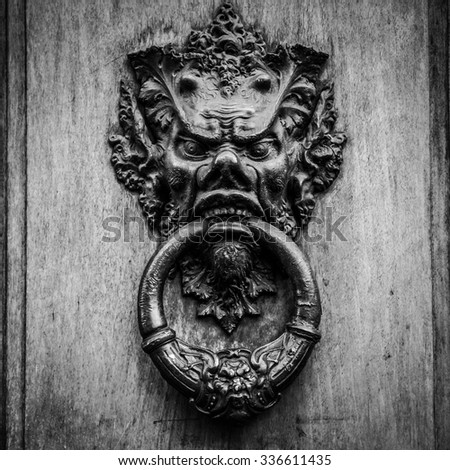 Door knoker on an old wodden door in Tuscany - Italy