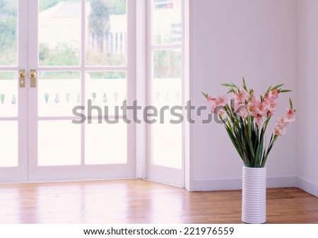 door leading into a contemporary room full of light,  - stock photo