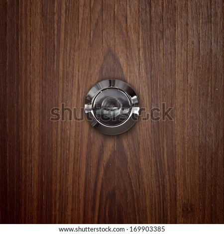 door lens peephole on lwooden.  - stock photo