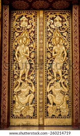 door made of wood and carved with the delicate and beautiful. - stock photo