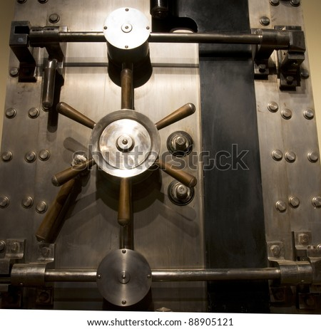 Door of a Vintage Locked Safe in a Bank Vault Retail Security  - stock photo