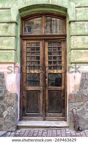 Door of an old house in Chernivtsi, Ukraine. - stock photo