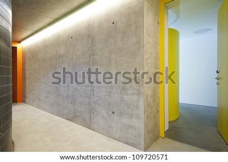 door of entry a flat, corridor, concrete wall - stock photo