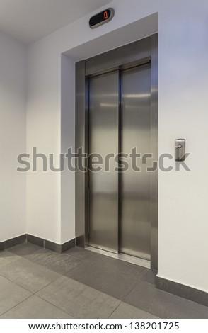 Door of lift in a modern building, vertical - stock photo