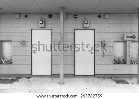 Door of the deserted house - stock photo