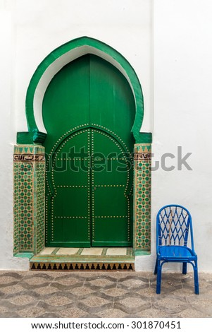 Door of the Mosque in the medina of Asilah, Morocco - stock photo