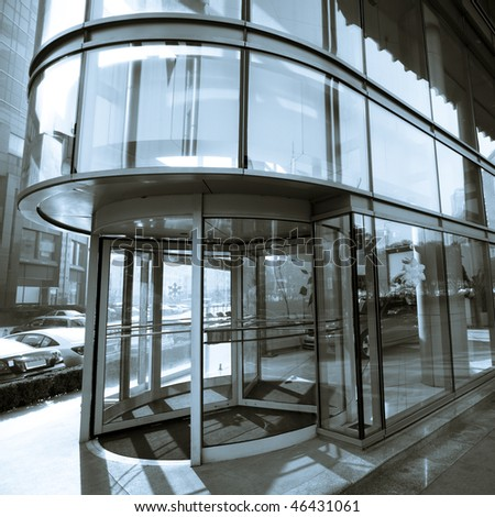 door of the office building in shanghai china. - stock photo