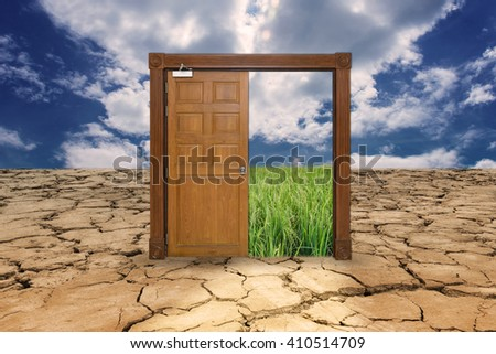 Door on drought land entrance to the rice field, gateway to comfortable
