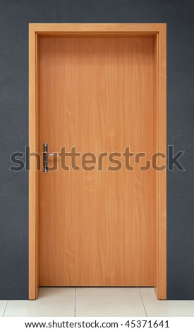 door on gray wall background - stock photo