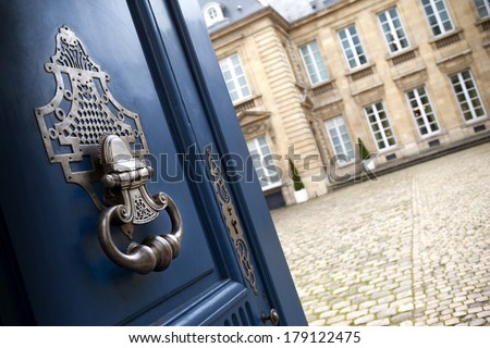 Door open to an old French mansion in Bordeaux - stock photo
