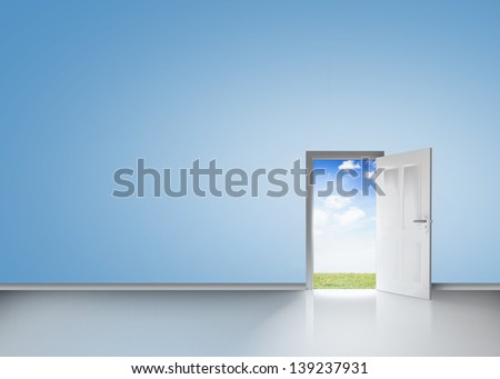 Door opening to reveal blue sky and meadow in a blue room - stock photo
