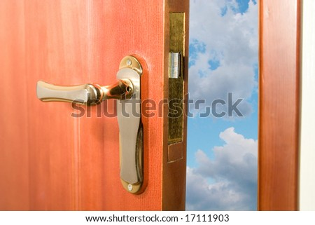 Door opening to the blue sky with clouds - stock photo