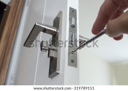 Door repairing. Close-up of repairing door - stock photo