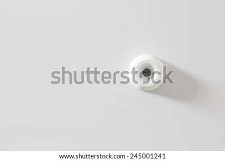Door stopper on the white wall