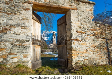 Door that opens to a mountain village