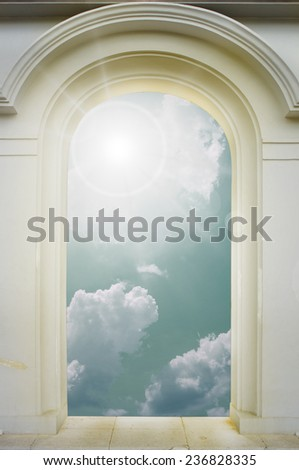 Door with arch opening to a beautiful  sky  - stock photo