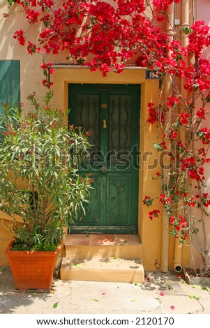 Door with flowers from Saint Tropez - stock photo