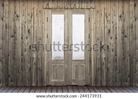 door with frosty window of wooden house background - stock photo