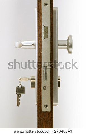 door with keys in lock - stock photo